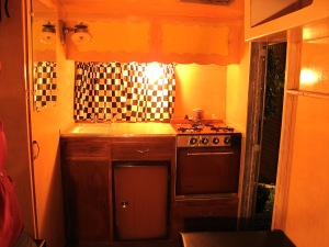 Here's the kitchenette area.  It has the original propane stove and oven as well as the ice box.  You'll also see the original gas lamp in the upper left corner.  I don't think I'll use that since it probably gets pretty warm.