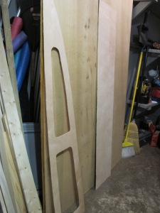 "New shelf pieces cut out of 1/8"" birch paneling."